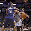 Memphis Grizzlies' James Johnson (3) fights for the ball with San Antonio Spurs' Marco Belinelli during the second half of an NBA basketball game, Sunday, April 6, 2014, in San Antonio. San Antonio coach Gregg Popovich was called for a technical foul ar