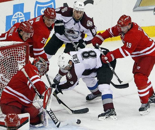 Colorado Avalanche's Jan Hejda (8) and Ryan O'Reilly (90) battle with Carolina Hurricanes' Jiri Tlusty (19), of the Czech Republic, Alexander Semin (28), of Russia, Justin Faulk (27) and goalie Justin Peters (35) during the third period of an NHL hockey game in Raleigh, N.C., Tuesday, Nov. 12, 2013. Hurricanes won 2-1
