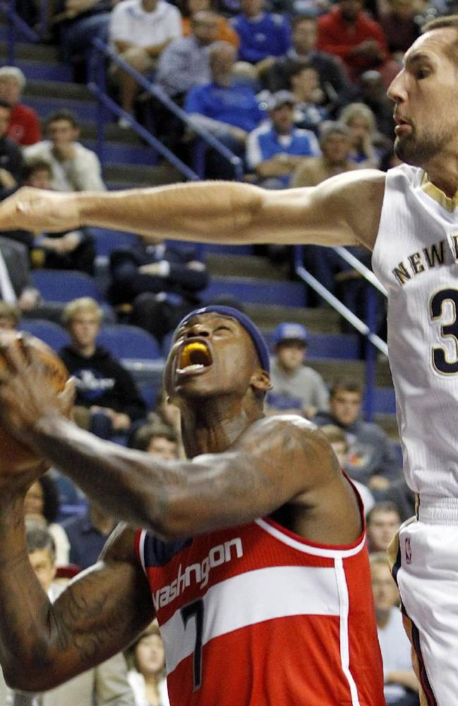 Washington's Al Harrington, left, looks for an opening on New Orleans' Ryan Anderson during an NBA basketball exhibition game on Saturday, Oct. 19, 2013, in Lexington, Ky