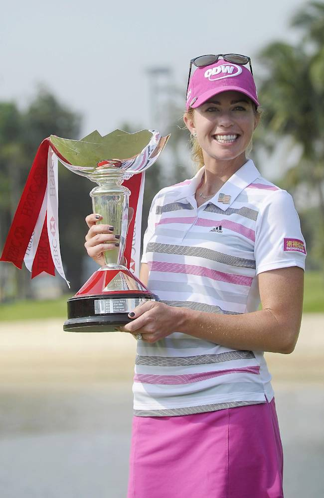 Paula Creamer of the U.S. poses with the trophy during the award ceremony of the HSBC Women's Champions golf tournament in Singapore, Sunday, Mar. 2, 2014
