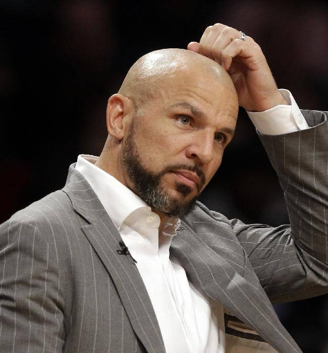 Brooklyn Nets' Jason Kidd scratches his head during the second half of the Nets' NBA basketball game against the New York Knicks on Tuesday, April 15, 2014, in New York. The Knicks won 109-98