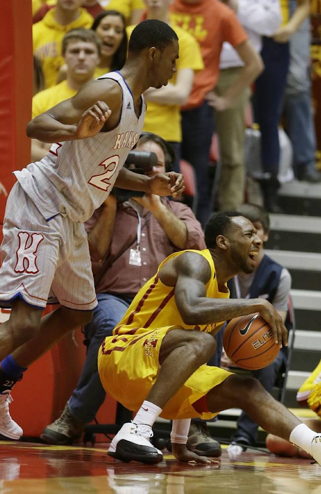 Iowa State guard DeAndre Kane, right, falls to the court in front of Kansas guard Andrew Wiggins, left, during the second half of an NCAA college basketball game, Monday, Jan. 13, 2014, in Ames, Iowa. Kansas won 77-70