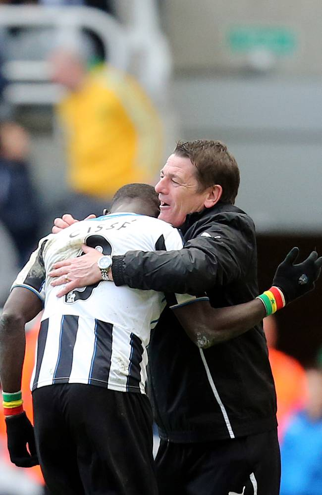 Newcastle United's Papiss Cisse, left, celebrates his goal with Head Coach John Carver, right, during their English Premier League soccer match against Crystal Palace at St James' Park, Newcastle, England, Saturday, March 22, 2014