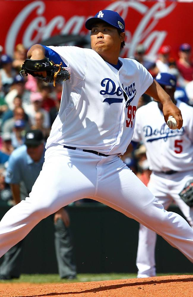 Los Angeles Dodgers' Ryu Hyun-jin pitches during the second game of the two-game Major League Baseball opening series between the Los Angeles Dodgers and Arizona Diamondbacks at the Sydney Cricket ground in Sydney, Sunday, March 23, 2014. The Dodgers won the game 7-5 and the series 2-0