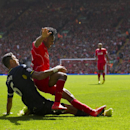 Liverpool's Raheem Sterling, right, fights for the ball against Southampton's Jose Fonte during their English Premier League soccer match at Anfield Stadium, Liverpool, England, Sunday Aug. 17, 2014