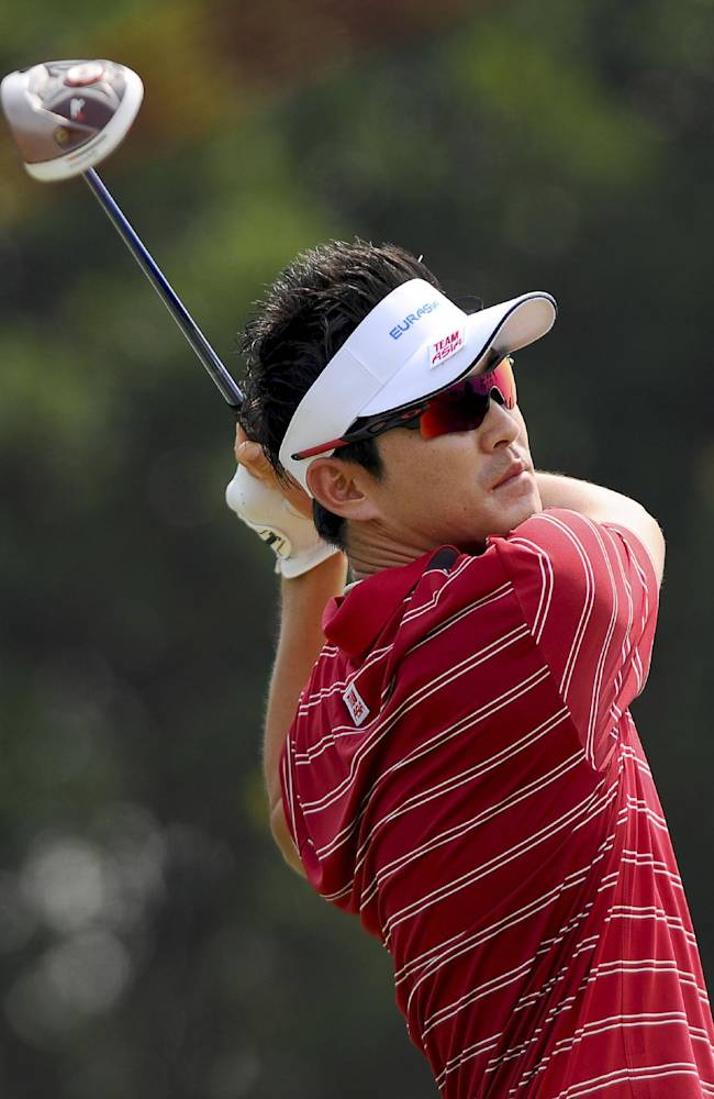 South Korea's Kim Hyung-sung watches his shot on the ninth hole during the second round of the EurAsia Cup golf tournament at the Glenmarie Golf and Country Club in Subang, Friday, March 29, 2014