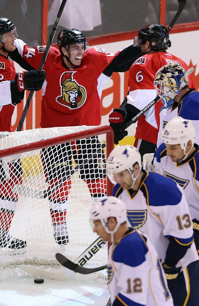 Ottawa Senators Jean- Gabriel Pageau (44) celebrates his goal during with teammates Erik Condra (22) and Robby Ryan (6) as St. Louis Blues goaltender Brian Elliot (1) and teammates Derek Roy (12) Carlo Colaiacovo (13) and Chrsi Stewrat (25) look on during first period NHL hockey action in Ottawa Monday, Dec. 16, 2013