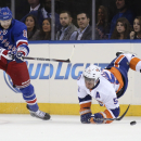 New York Islanders center Frans Nielsen (51) falls after being tripped by New York Rangers left wing Rick Nash (61) during the first period of an NHL hockey game at Madison Square Garden, Tuesday, Oct. 14, 2014, in New York The Associated Press