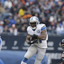 Detroit Lions running back Reggie Bush (21) runs against Chicago Bears defenders in the first half of an NFL football game Sunday, Dec. 21, 2014, in Chicago. (AP Photo/Nam Y. Huh)
