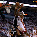 MIAMI, FL - JUNE 06: LeBron James #6 of the Miami Heat goes up for a shot against Tim Duncan #21 of the San Antonio Spurs in the first quarter during Game One of the 2013 NBA Finals at AmericanAirlines Arena on June 6, 2013 in Miami, Florida. (Photo by Mike Ehrmann/Getty Images)