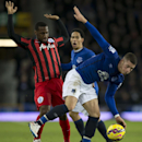 Everton's Ross Barkley, right, fights for the ball against Queens Park Rangers' David Hoilett during the English Premier League soccer match between Everton and Queens Park Rangers at Goodison Park Stadium, Liverpool, England, Monday Dec. 15, 2014