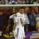 Real Madrid's Karim Benzema, left, celebrates with Cristiano Ronaldo after scoring his side's second goal during the Champions League group B soccer match between Liverpool and Real Madrid at Anfield Stadium, Liverpool, England, Wednesday Oct. 22, 2014