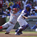 Cincinnati Reds' Todd Fraiser (21) slides safely into home plate on a single hit by Ryan Ludwick as Chicago Cubs catcher Welington Castillo, right, waits for the throw during the fifth inning of a baseball game in Chicago, Saturday, April 20, 2014. Cincin