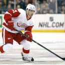 Detroit Red Wings' Tomas Tatar skates with the puck during the first period of a first-round NHL playoff hockey game against the Boston Bruins in Boston Friday, April 18, 2014. (AP Photo/Winslow Townson)