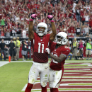 Arizona Cardinals wide receiver Larry Fitzgerald (11) celebrates his touchdown with teammate John Brown during the first half of an NFL football game against the Washington Redskins, Sunday, Oct. 12, 2014, in Glendale, Ariz The Associated Press