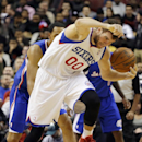 Philadelphia 76ers' Spencer Hawes (00) chases down a loose ball over Los Angeles Clippers' Jared Dudley (9) during the first half of an NBA basketball game, Monday, Dec. 9, 2013, in Philadelphia The Associated Press