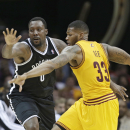 Cleveland Cavaliers' Alonzo Gee, right, knocks the ball loose from Brooklyn Nets' Andray Blatche during the second quarter of an NBA basketball game Wednesday, April 16, 2014, in Cleveland. (AP Photo/Tony Dejak)
