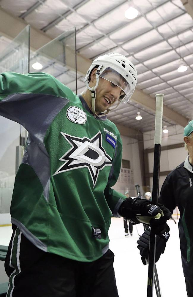 Dallas Stars right wing Alex Chiasson, left, and head coach Lindy Ruff share a laugh as they come off the ice during NHL hockey camp Thursday, Sept. 19, 2013, in Frisco, Texas