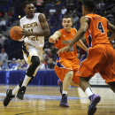 Wichita State's Cleanthony Early (11) drives against Evansville's Blake Simmons (50) and Duane Gibson (4) during the second half of an NCAA college basketball game in the quarterfinals of the Missouri Valley Conference men's tournament, Friday, March 7, 2014 in St. Louis. (AP Photo/Bill Boyce)