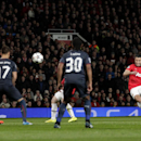 Manchester United's Robin van Persie, right, scores a free kick for his hatrick and his side's third goal during their Champions League last 16 second leg soccer match against Olympiakos at Old Trafford Stadium, Manchester, England, Wednesday, March 19, 2