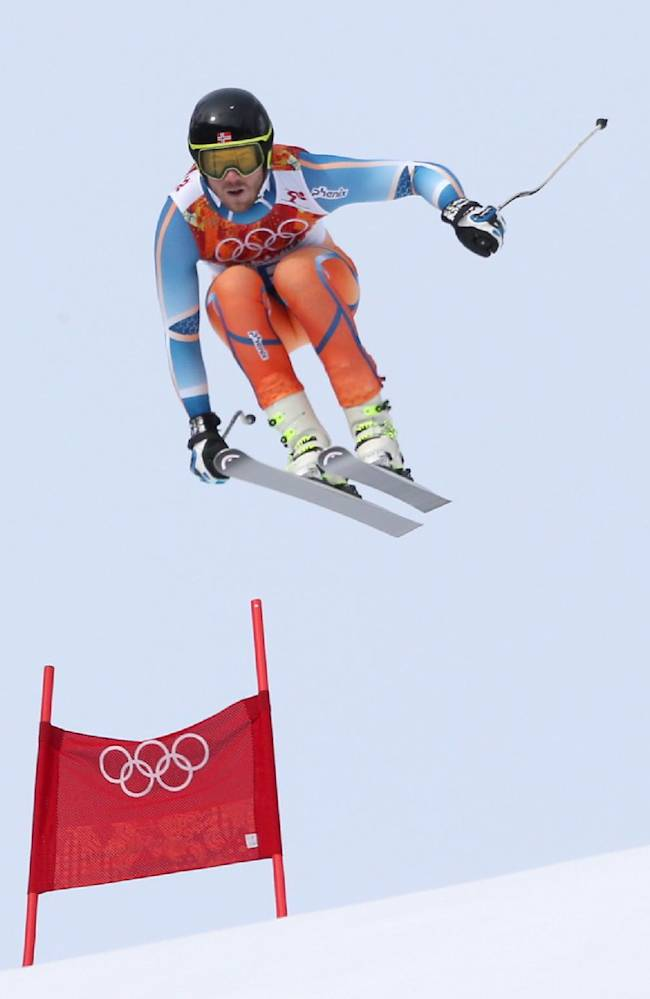 Norway's Kjetil Jansrud makes a jump to win the bronze medal in the men's downhill at the Sochi 2014 Winter Olympics, Sunday, Feb. 9, 2014, in Krasnaya Polyana, Russia