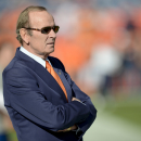 In this Dec. 2, 2012 file photo, Denver Broncos owner Pat Bowlen watches as the Broncos warm up before an NFL football game against the Tampa Bay Buccaneers in Denver. Bowlen is giving up control of the team as he battles Alzheimer's disease. The team ann