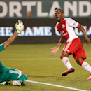 Timbers forward (6) Darlington Nagbe curls a shot around FC Dallas keeper (1) Raul Fernandez to score the Timbers' second goal in the first half. The Portland Timbers led FC Dallas 2-1 at half in Portland. (AP Photo/The Oregonian, Doug Beghtel)