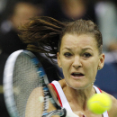 Agnieszka Radwanska of Poland returns a ball to Maria Sharapova of Russia during the Fed Cup World Group first round tennis match between Poland and Russia in Krakow, Poland, Sunday, Feb. 8, 2015 . ( AP Photo/Czarek Sokolowski)