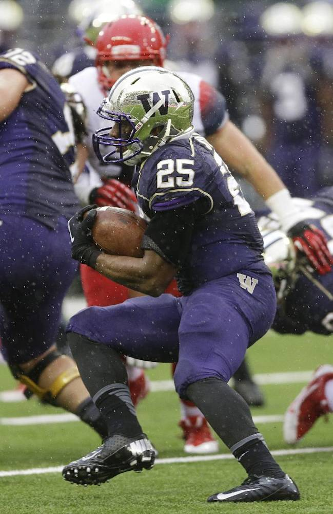 Washington's Bishop Sankey (25) runs the ball during the first half of an NCAA college football game against Arizona, in this Sept. 28, 2013 taken in Seattle. The college football weekend is highlighted by several teams that have gotten off to excellent starts, but still have much prove