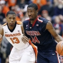 Arizona forward Solomon Hill, right, drives against Oregon State guard Langston Morris-Walker during the second half of an NCAA college basketball game in Corvallis, Ore., Saturday, Jan. 12, 2013. Hill scored 16 points as Arizona defeated Oregon State 80-70. (AP Photo/Don Ryan)