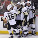 Pittsburgh Penguins' Brandon Sutter, from left, Matt Cooke, Tyler Kennedy, Brooks Orpik and Paul Martin celebrate Kennedy's goal against the Ottawa Senators during the second period of Game 4 of their Stanley Cup Eastern Conference semifinal NHL hockey series at Scotiabank Place in Ottawa on Sunday, May 19, 2013. (AP Photo/The Canadian Press, Patrick Doyle)