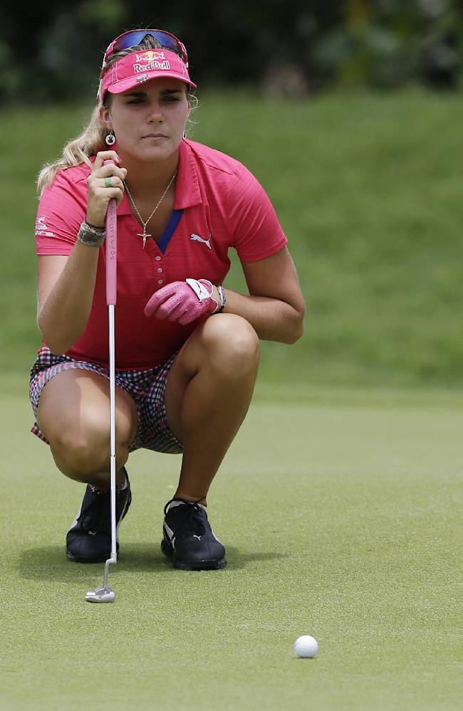 Lexi Thompson of the US lines up her putt during the third round at the Malaysian LGPA event in Kuala Lumpur, Saturday, Oct. 12, 2013