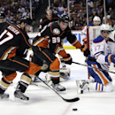 Anaheim Ducks' Ryan Kesler, left, Matt Beleskey, center, and Edmonton Oilers' David Perron compete for the puck during the third period of an NHL hockey game Wednesday, Dec. 10, 2014, in Anaheim, Calif. The Ducks won 2-1 The Associated Press