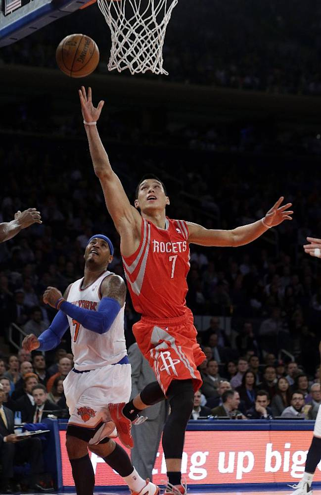 Houston Rockets' Jeremy Lin drives past New York Knicks' Carmelo Anthony during the second half of an NBA basketball game Thursday, Nov. 14, 2013, in New York. The Rockets won 109-106