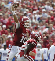 Oklahoma quarterback Blake Bell (10) passes over teammate Roy Finch (22) in the first quarter of an NCAA college football game against Tulsa in Norman, Okla., Saturday, Sept. 14, 2013. (AP Photo/Sue Ogrocki)