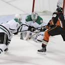 Dallas Stars' Kari Lehtonen, center, of Finland, stops a shot by Anaheim Ducks' Corey Perry, right, as Stars' Trevor Daley helps defend during the first period in Game 2 of the first-round NHL hockey Stanley Cup playoff series on Friday, April 18, 2014, i
