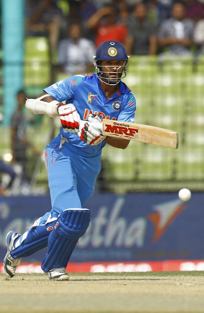 India's Shikhar Dhawan plays a shot during the Asia Cup one-day international cricket tournament against Sri Lanka in Fatullah, near Dhaka, Bangladesh, Friday, Feb. 28, 2014