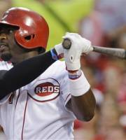Cincinnati Reds' Brandon Phillips watches his three-run double off Pittsburgh Pirates relief pitcher Justin Wilson in the fifth inning of a baseball game, Friday, July 19, 2013, in Cincinnati. (AP Photo/Al Behrman)