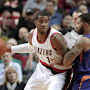 Portland Trail Blazers forward LaMarcus Aldridge, left, backs in on Phoenix Suns forward Markieff Morris during the first half of an NBA basketball game in Portland, Ore., Friday, April 4, 2014 The Associated Press