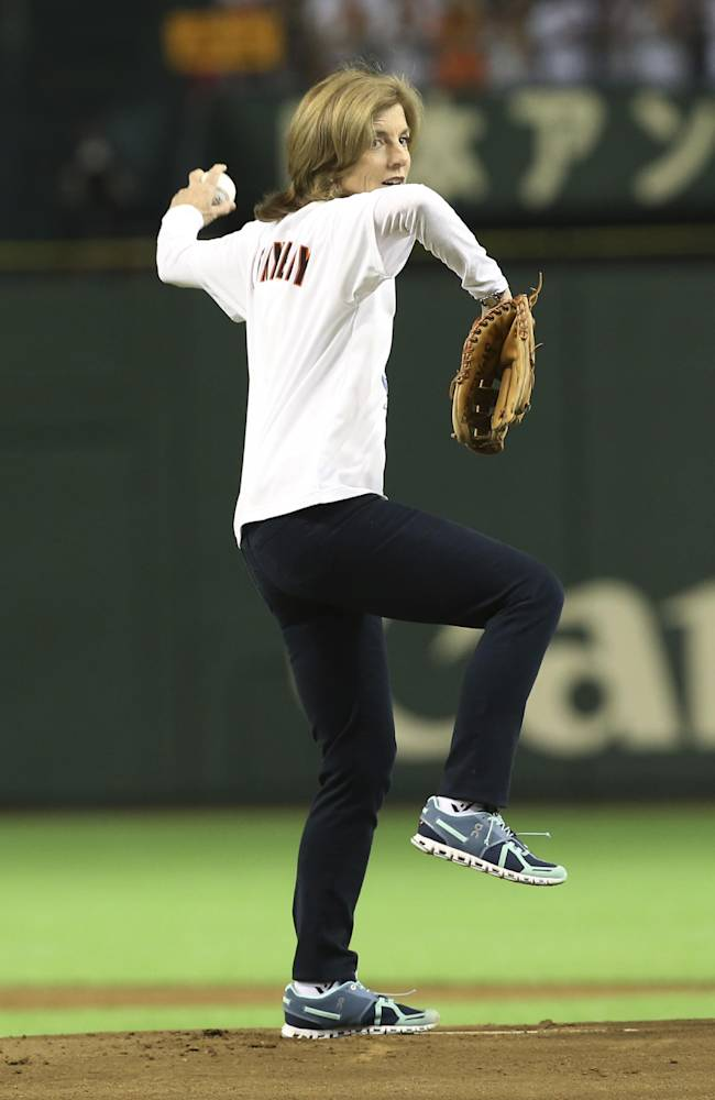 U.S. Ambassador to Japan Caroline Kennedy throws out the ceremonial first pitch before the Japan's Central League opening game between the Yomiuri Giants and the Hanshin Tigers at Tokyo Dome in Tokyo, Friday, March 28, 2014