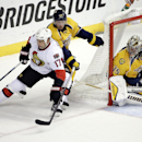 Ottawa Senators center David Legwand (17) brings the puck around the net as he is defended by Nashville Predators center Derek Roy (21) and goalie Pekka Rinne (35), of Finland, in the first period of an NHL hockey game Thursday, Oct. 9, 2014, in Nashville