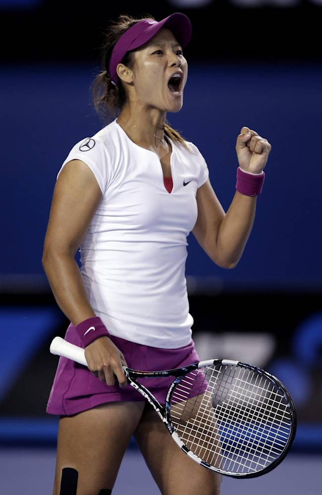 Li Na of China celebrates winning the first set over Dominika Cibulkova of Slovakia  during their women's singles final at the Australian Open tennis championship in Melbourne, Australia, Saturday, Jan. 25, 2014