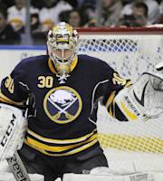 Buffalo Sabres goaltender Ryan Miller stays focused on an incoming Carolina Hurricanes shot during the second period of an NHL hockey game in Buffalo, N.Y., Tuesday, Feb. 25, 2014. (AP Photo/Gary Wiepert)