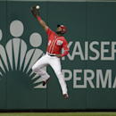 Washington Nationals center fielder Denard Span (2) leaps for but misses a San Francisco Giants' Joe Panik triple on the seventh inning of Game 1 of baseball's NL Division Series, Friday, Oct. 3, 2014, at Nationals Park in Washington The Associated Press