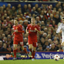 Real Madrid's Cristiano Ronaldo, right, races away from Liverpool's Steven Gerrard, left, during the Champions League group B soccer match between Liverpool and Real Madrid at Anfield Stadium, Liverpool, England, Wednesday Oct. 22, 2014