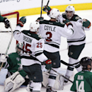 Minnesota Wild's Jonas Brodin (25), Charlie Coyle (3), and Matt Moulson (26) celebrate Coyle's goal in the second period during an NHL hockey game against the Dallas Stars in Dallas on Saturday, March 8, 2014 The Associated Press
