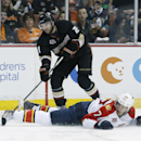 Florida Panthers defenseman Tom Gilbert slides to deflect a pass from Anaheim Ducks right wing Kyle Palmieri during the second period of an NHL hockey game, Sunday, March 23, 2014 in Anaheim, Calif The Associated Press