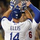 Los Angeles Dodgers' Mark Ellis and Jarry Hairston Jr. celebrate as both score on Ellis' home run against the San Diego Padres in the sixth inning of a National League baseball game in Los Angeles, Friday, July 13, 2012. (AP Photo/Reed Saxon)