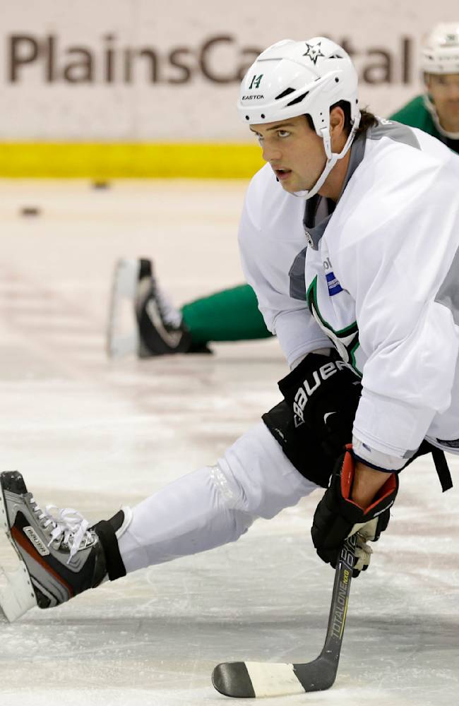 Dallas Stars left wing Jamie Benn (14) stretches with teammates during NHL hockey training camp Thursday, Sept. 19, 2013, in Frisco, Texas