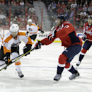 Philadelphia Flyers' Claude Giroux (28) battles for the puck against Washington Capitals' Karl Alzner,right, during the second period of a preseason NHL hockey game, Thursday, Oct. 2, 2014, in Washington. The Capitals won 3-2 in a shootout The Associated